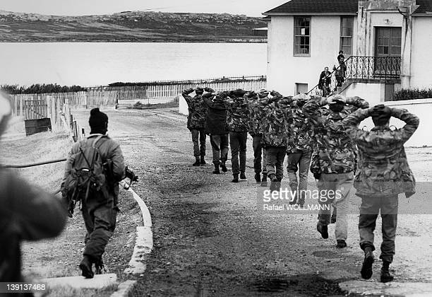 British soldiers surrender to Argentine troops that invaded the islands on April 2 1982 in Port Stanley Falklands Islands