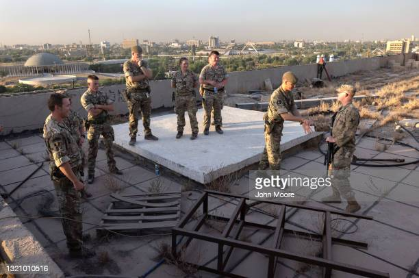 British soldiers thank an American soldier for guiding them to a rooftop view in the International Zone on May 29, 2021 in Baghdad, Iraq. Coalition...