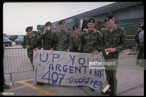 British soldiers w UP YOURS ARGENTINA banner before sailing on QE2 for Falklands