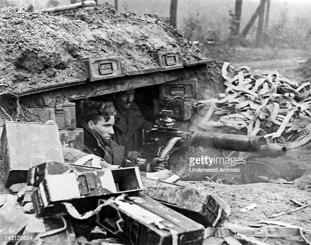 British soldiers with a Vickers machine gun give support to advancing infantrymen during an offensive, Nijmegen, Netherlands, February 8, 1945.