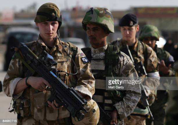 British soldiers with the 1st Battalion The Yorkshire Regiment conduct a joint foot patrol with soldiers from the Iraqi Army at the Al Harthah market...