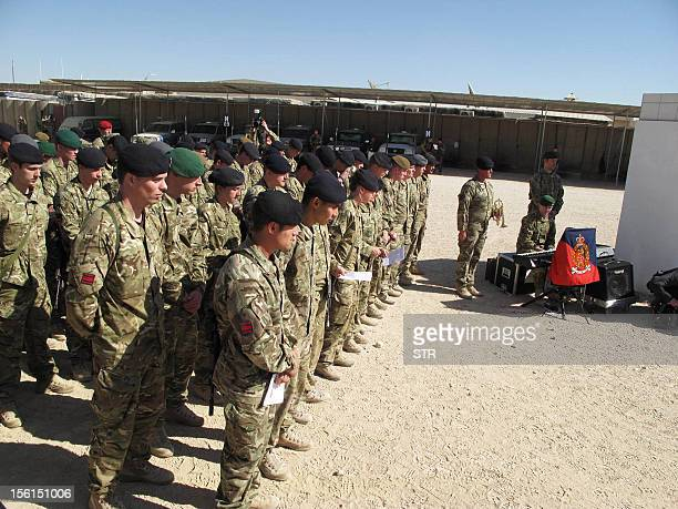 British soldiers with the NATO led International Security Assistance Force observe a moment of silence during Britain's Veterans Day ceremony at a...