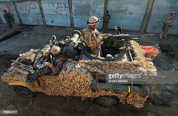 British soldiers with the NATOled International Security Assistance Force stand on their vehicle as they patrol in the town of Musa Qala in Helmand...