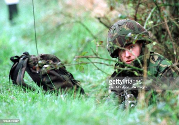 British solider lies in amongst the bushes a mile from the village of Forkhill in County of Armagh Northern Ireland this morning as security forces...