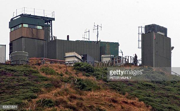 British solider wait on a Army helicopter at the watchtower at Sugar loaf mountain in Camlock, Co. Armagh, 29 July 2005. The Army has begun...
