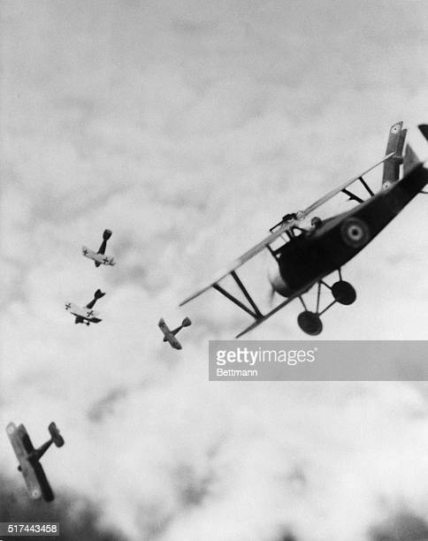 British Sopwith Camel in battle with German biplanes during World War I.