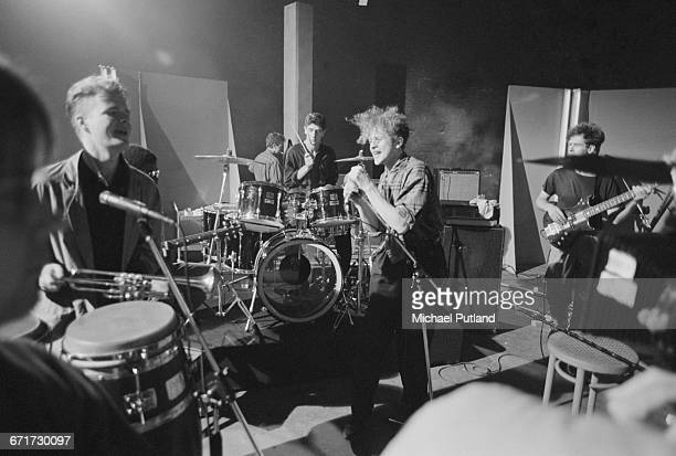 British soul and pop group Simply Red performing at a video shoot in London September 1985 Left to right Tim Kellett Chris Joyce Mick Hucknall and...