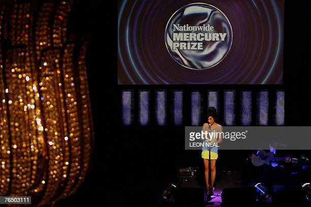 British soul singer Amy Winehouse performs onstage at the Grosvenor Hotel on Park Lane during the Mercury Music Awards ceremony London 4 September...