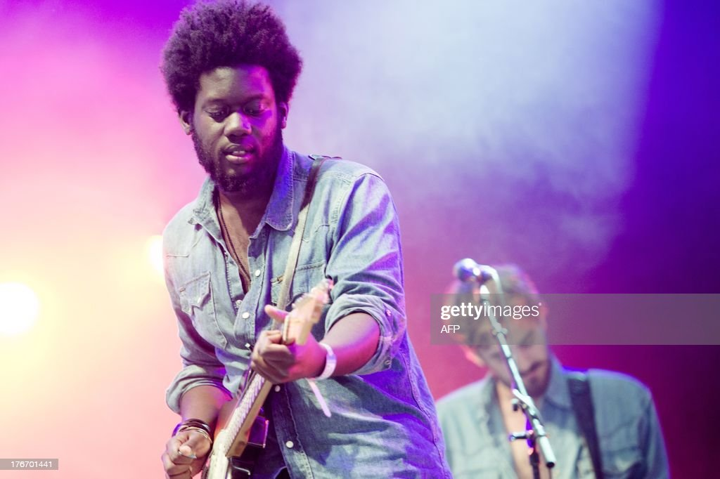 British soul singer Michael Kiwanuka performs on stage during the second day of the Lowlands festival in Biddinghuizen, on August 17, 2013. The music festival runs from August 16 to 18, 2013.