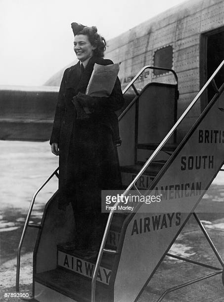 British South American Airways hostess Mary Guthrie about to board the Lancastrian airliner 'Star Dust' at Heathrow Airport, before a test-flight to...