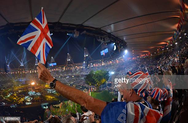 British spectators cheer as they attend the opening ceremony of the London 2012 Olympic Games on July 27 2012 at the Olympic stadium in London AFP...