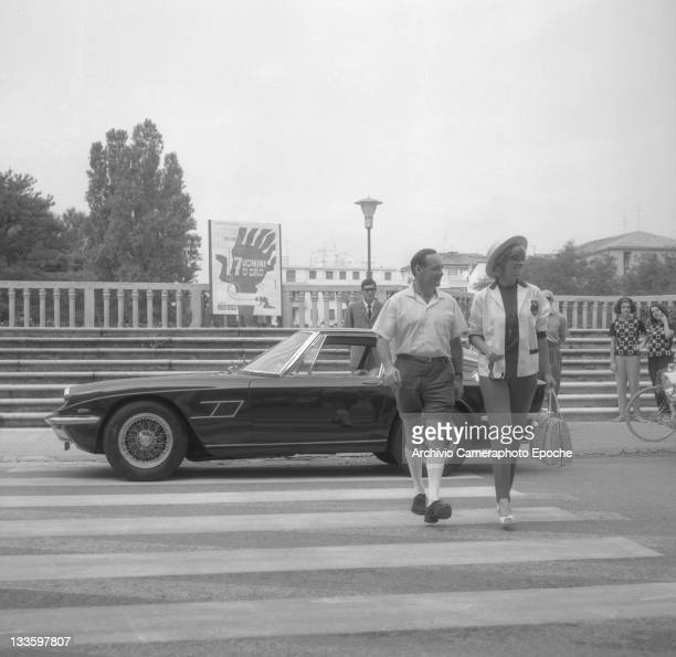 British speed record breaker Donald Campbell crossing the street with his wife Tonia Bern Lido Venice 1965