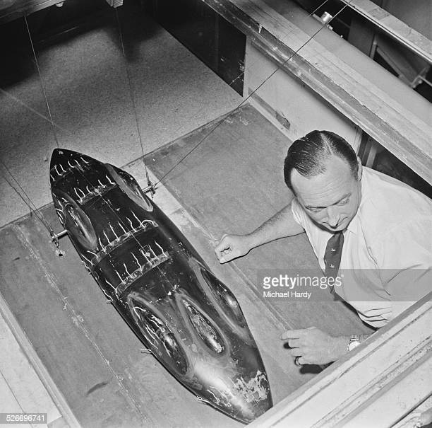 British speed record breaker Donald Campbell testing a model of the Bluebird car in a wind tunnel 1st August 1958