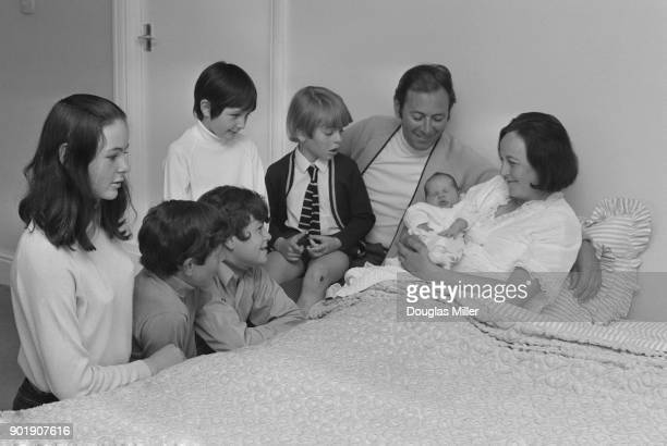British sports commentator David Coleman with his wife Barbara who has just given birth to their sixth child at their home in Stoke Poges...