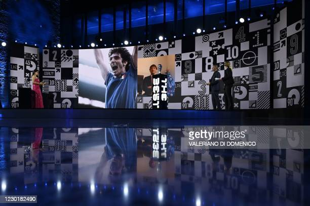 British sports journalist Reshmin Chowdhury and Dutch manager and former player Ruud Gullit looks on during a tribute to late Italian football player...