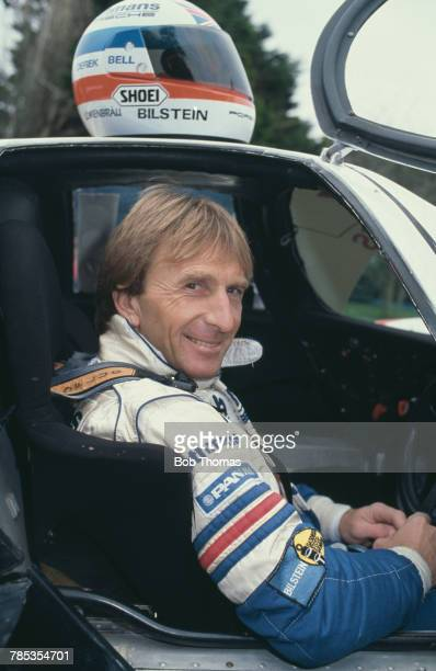 British sportscar racing driver Derek Bell pictured seated in the driver's seat of his Porsche 956 racing car at home in West Sussex England on 23rd...