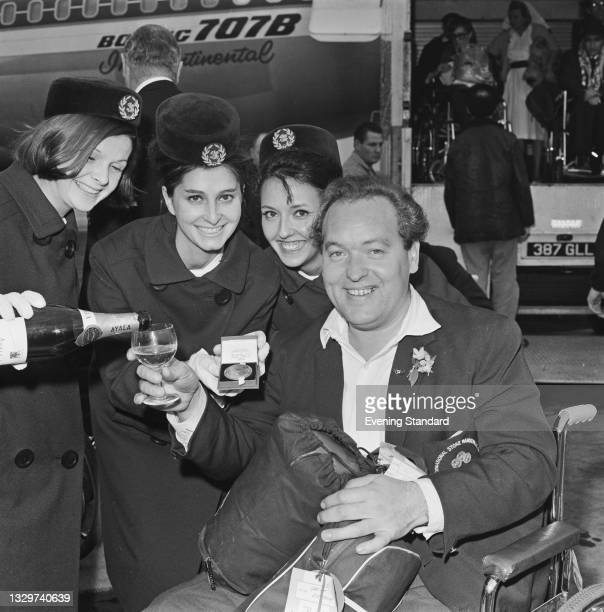 British sportsman Michael Shelton returns to the UK with his medal after competing in the Summer Paralympic Games in Tokyo, 26th November 1964.