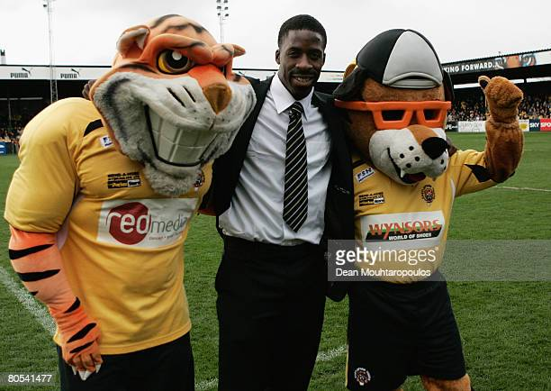 British sprinter Dwain Chambers poses with the mascots prior to the Super League match between Castleford Tigers and St Helens at the Jungle on April...