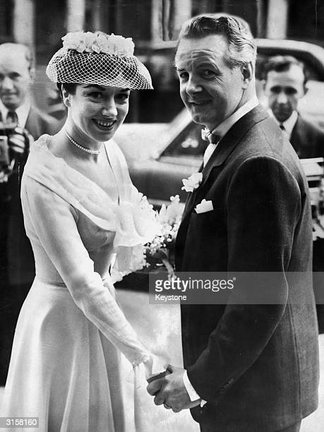 British stage actor and radio presenter Hubert Gregg with his wife actress Pat Kirkwood after their wedding at St Columba's church London