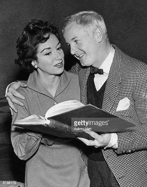 British stage actor and radio presenter Hubert Gregg with his wife actress Pat Kirkwood October 1960 The couple are studying their script at the...