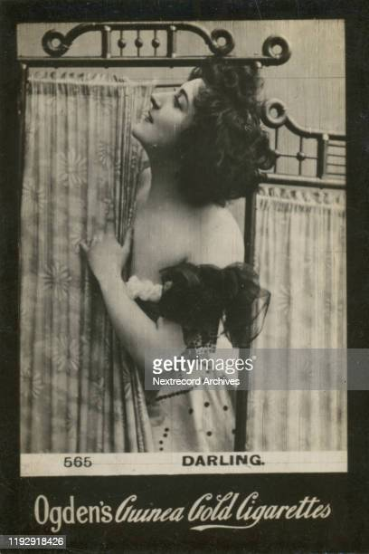 British stage actress exclaims 'Darling' to an invisible paramour out of frame as she undresses behind a screen depicted on collectible tobacco card...