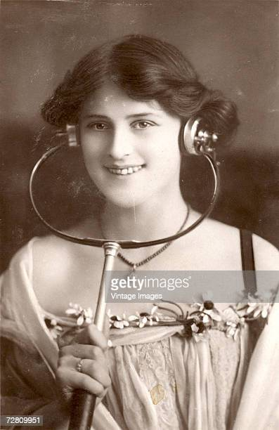 British stage actress Zena Dare models some sort of acoustic headset, 1900s.