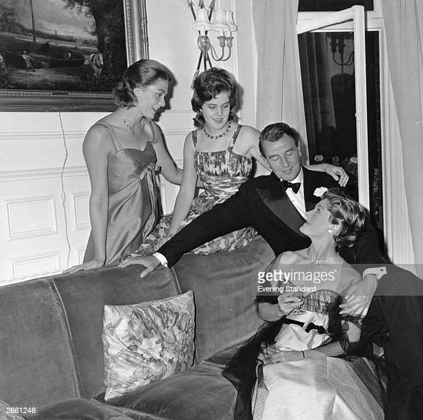British stage and film actor Sir Michael Scudamore Redgrave celebrating his silver wedding anniversary with his wife actress Rachel Kempson and two...