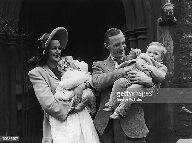 British stage and screen actress Judy Campbell with her husband Lieutenant Commander David Birkin at the christening of their baby daughter, the...