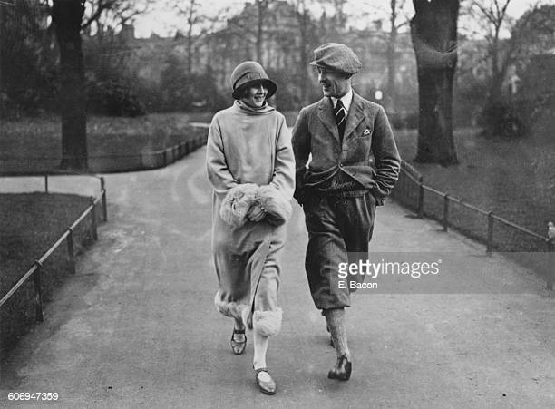 British stage magician Jasper Maskelyne strolling in Regent's Park London with his fiancee and stage assistant Evelyn HomeDouglas 7th February 1925