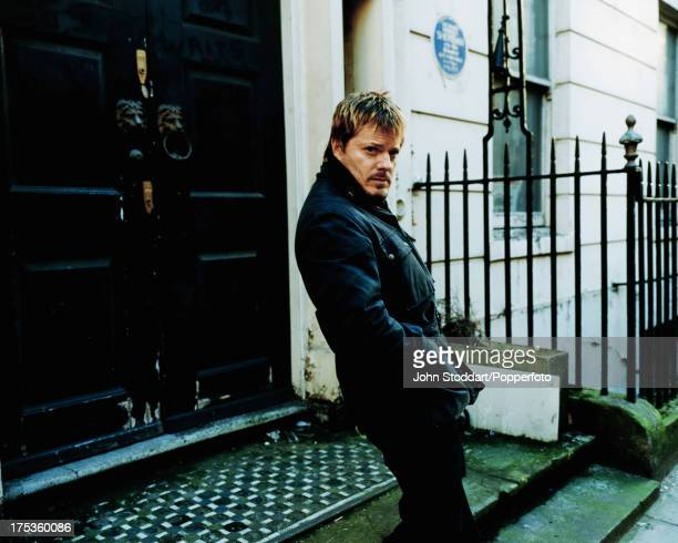 British standup comedian and actor Eddie Izzard on Hertford Street London circa 2000 Behind him is a blue plaque for playwright Richard Brinsley...