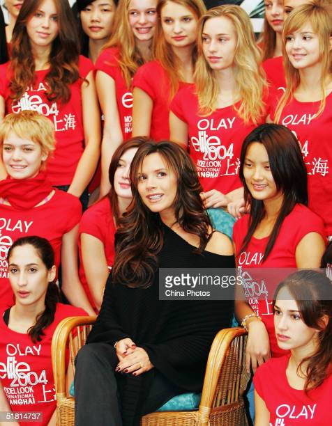 British star Victoria Beckham poses for pictures with model contestants at a news conference of Elite Model Look 2004 International Finals on...