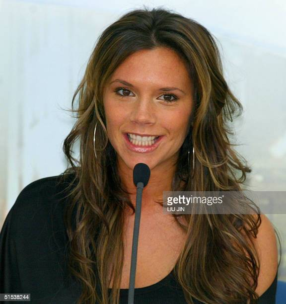 British star Victoria Beckham smiles while answering a question during a press conference announcing she will be the celebrity guest judge of Elite...