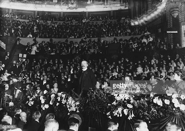 British statesman David Lloyd George , addresses the crowd at a suffragette meeting at the Albert Hall.