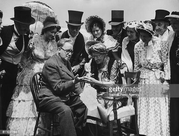 British statesman Herbert Morrison has his palm read by Mrs Vaughan Williams at the Brockham Green Festival in Surrey 2nd July 1951