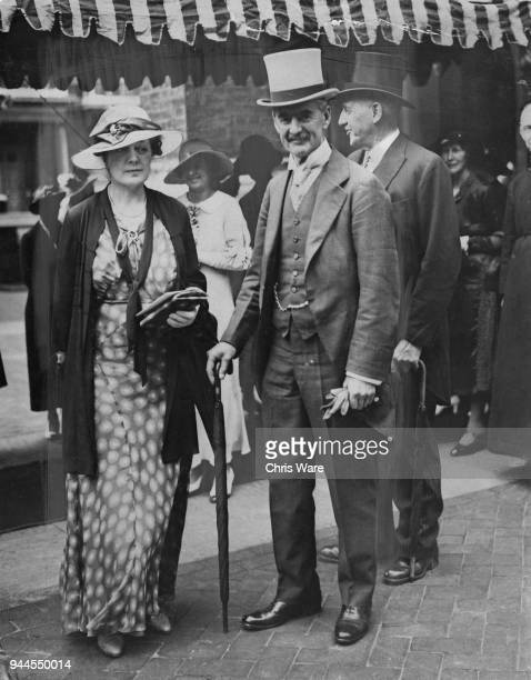 British statesman Neville Chamberlain Chancellor of the Exchequer and his wife Anne are guests at the wedding of Alexander Richard Nevill and Grania...