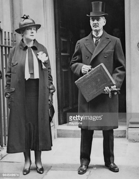 British statesman Neville Chamberlain Chancellor of the Exchequer leaves Downing Street in London to present his budget at the House of Commons...