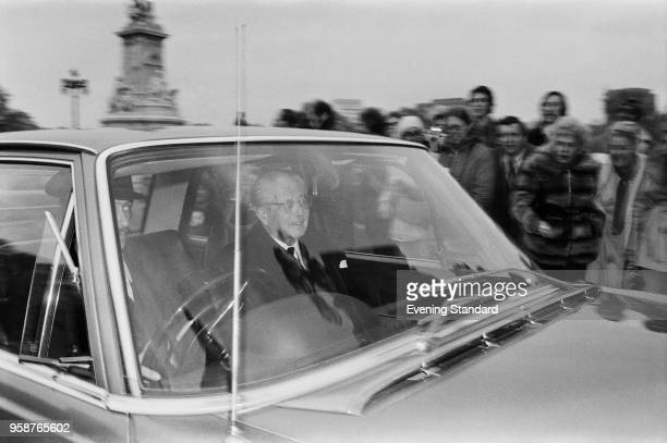British statesman of the Conservative Party and former Prime Minister of the UK Harold Macmillan on a car directed to Buckingham Palace following the...