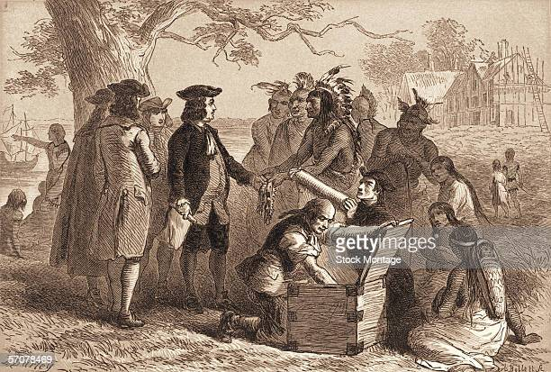 British statesman William Penn accepts a belt from Tamanend chief of the LenniLenape Indians as part of treaty in which Penn purchased a section of...