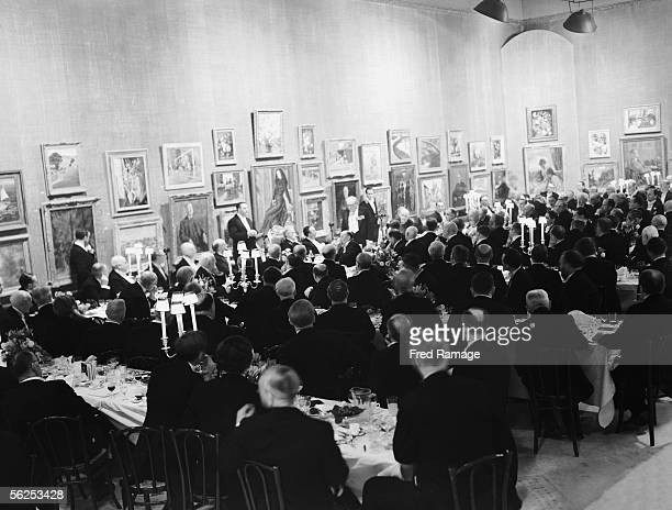 British statesman Winston Churchill addresses diners at the inaugural banquet of the Royal Academy's summer season at Burlington House London 28th...