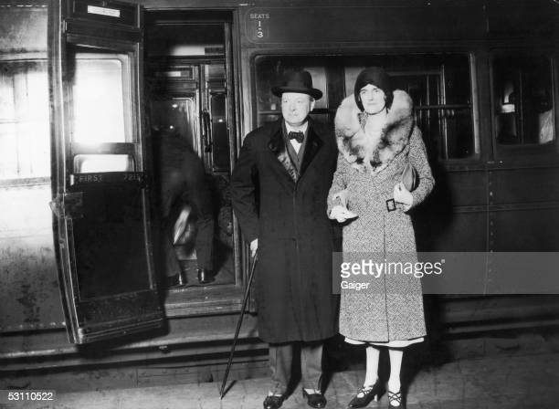 British statesman Winston Churchill and his wife Clementine arrive at Waterloo Station in London after a visit to the United States November 1929