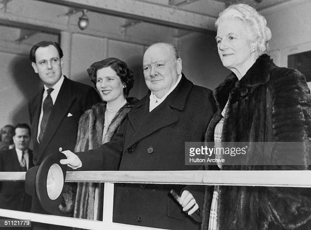 British statesman Winston Churchill and his wife Clementine arrive in New York on the Cunard liner 'Queen Elizabeth' accompanied by their daughter...