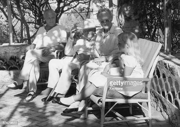 British statesman Winston Churchill and Lady Clementine Churchill , celebrating their golden wedding at Cap d'Ail, Nice, France. With them is their...