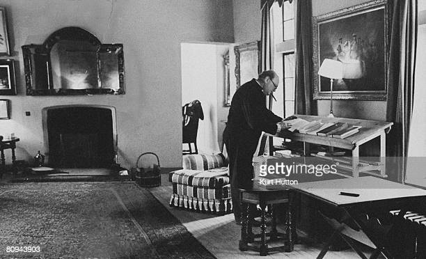 British statesman Winston Churchill at home in the study of his Chartwell estate in Kent, 25th February 1939. Most of his work is done standing up at...
