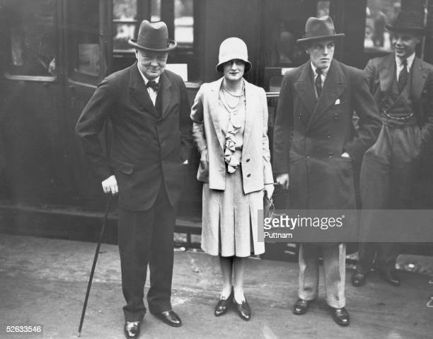 British statesman Winston Churchill at Waterloo Station, London, at the start of a trip to canada with his son Randolph , 3rd August 1929. Seeing...