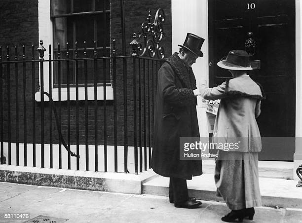 British statesman Winston Churchill buys a flag outside 10 Downing Street on Veteran's Day, October 1919.