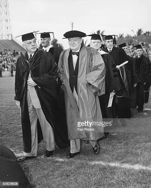British statesman Winston Churchill enters the Burdina Stadium to recieve an honorary degree from the University of Miami with Dr Bowman Ashe,...
