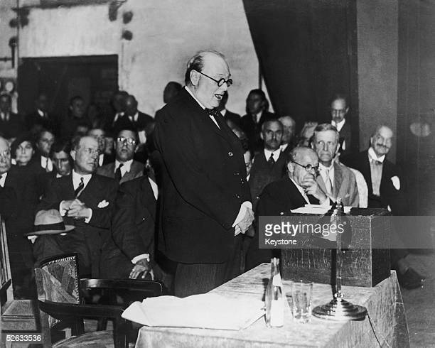 British statesman Winston Churchill gives a speech in praise of the French army to an audience of French politicians at the Ambassadeurs Theatre,...