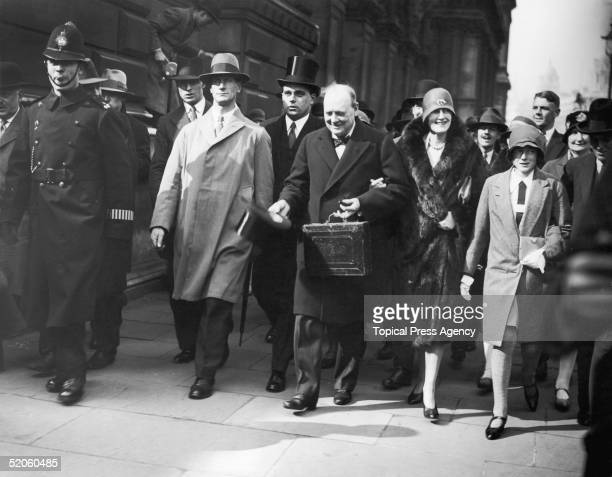 British statesman Winston Churchill , his wife Clementine , their daughter Sarah and son Randolph , on the way to the House of Commons on Budget Day,...