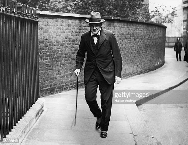 British statesman Winston Churchill makes his way to Number 10 Downing Street for a meeting September 1922