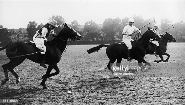 British statesman Winston Churchill on the ball during the annual polo match between the House of Commons and the House of Lords for the Harrington...